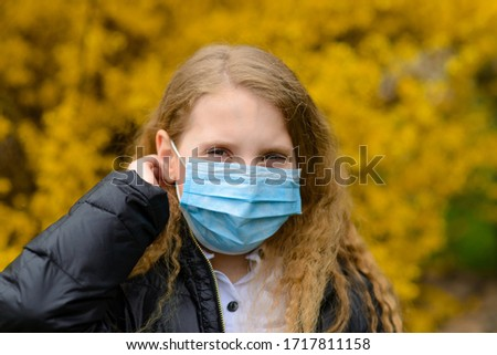 Portrait of sad caucasian child in face mask on closed playground outdoor. Coronavirus social distance quarantine. #1717811158