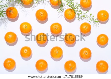 Fresh organic clementines in a geometric array on white background #1717815589