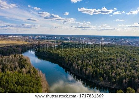 A panorama of the city of Ivanovo with the Kharinka river from a bird's flight on a spring cloudy day, photo taken from a quadrocopter. #1717831369