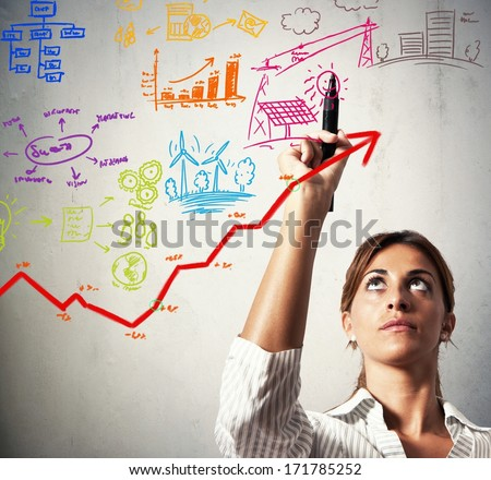 Businesswoman drawing business project with growing profit