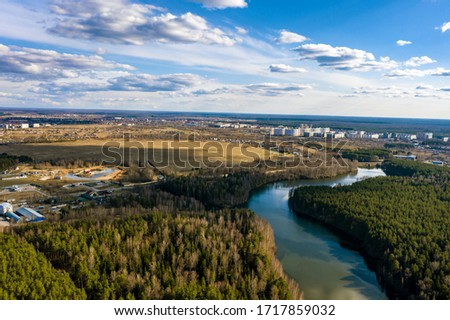 A panorama of the city of Ivanovo with the Kharinka river from a bird's flight on a spring cloudy day, photo taken from a quadrocopter.  #1717859032