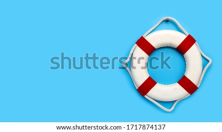Lifebuoy on blue background. Copy space Royalty-Free Stock Photo #1717874137