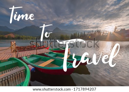 Evening landscape with boats on water and mountains and hand lettering text time to travel