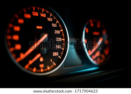 Car speedometer and odometer close up view Royalty-Free Stock Photo #1717904623