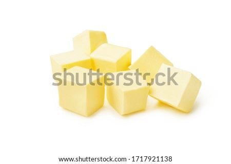 Pieces of butter isolated on white background. Butter cubes. #1717921138