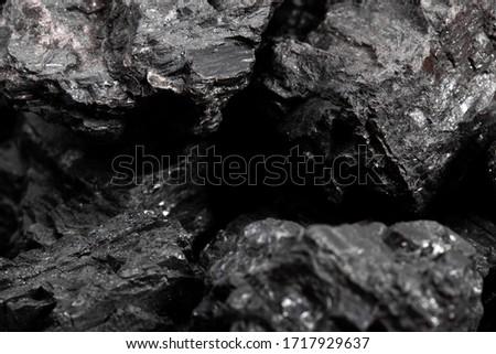 pieces of black coal close up #1717929637