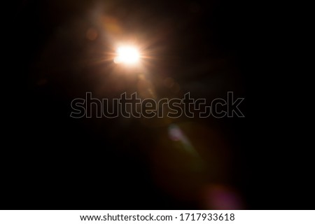 Abstract Natural Sun flare on the black Royalty-Free Stock Photo #1717933618