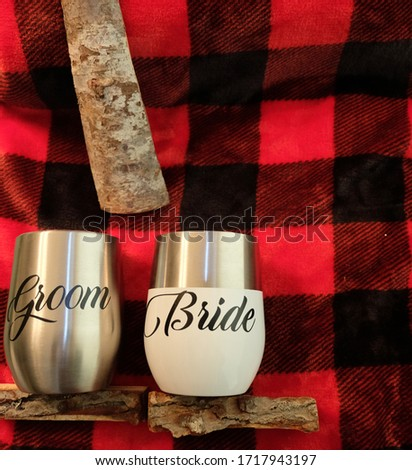 bride and groom monogram on a plaid background