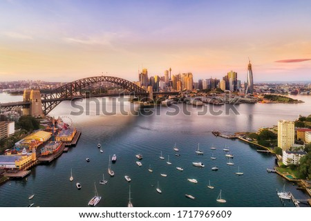 Sunrise in Sydney city - aerial view from Lavender bay to the Sydney harbour bridge and CBD skyline. Royalty-Free Stock Photo #1717969609