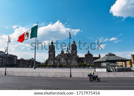 Mexico City, Mexico ; April 26 2020: Zocalo square and metropolitan cathedral in the historic center of Mexico City closed during Coronavirus outbreak. #1717975456