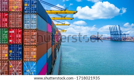 Container ship unloading in deep sea port crane, Global business logistic import export freight shipping transportation oversea worldwide container ship, Container vessel loading cargo freight ship. Royalty-Free Stock Photo #1718021935