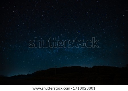 Starry sky on a background of a slope, night landscape. Astrology, horoscopes, astro screensaver, space