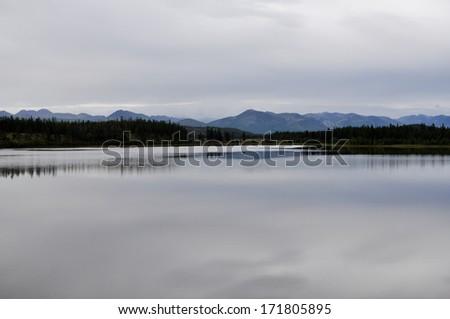 Yakut landscape in the area of Oymyakon highland ridge Suntar-khayata. Mountain lake. #171805895