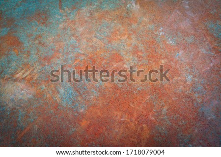 Rusty iron. The texture of the old rusty metal sheet. Closeup. Royalty-Free Stock Photo #1718079004