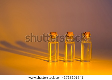 Three glass corked bottles filled with liquid. Background for science and medicine. Virus vaccine. #1718109349