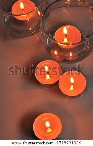candles in glasses, romantic mood, glare of fire flame