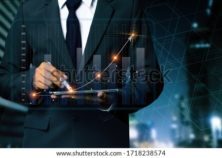Double exposure of businessman working on digital tablet and smart phone with digital marketing virtual chart, Abstract icon, Business strategy concept.