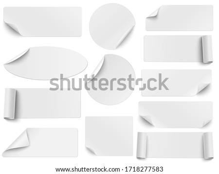 Set of vector white paper stickers of different shapes with curled corners isolated on white background. Round, oval, square, rectangular shapes. Royalty-Free Stock Photo #1718277583