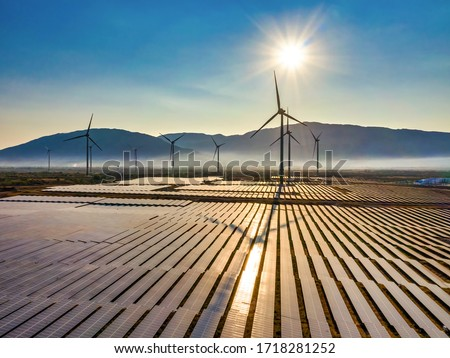 Aerial view of windmill and Solar panel, photovoltaic, alternative electricity source - concept of sustainable resources on a sunny day, Bac Phong, Thuan Bac, Ninh Thuan, Vietnam #1718281252