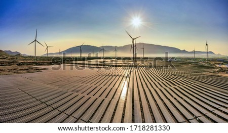 Aerial view of windmill and Solar panel, photovoltaic, alternative electricity source - concept of sustainable resources on a sunny day, Bac Phong, Thuan Bac, Ninh Thuan, Vietnam #1718281330