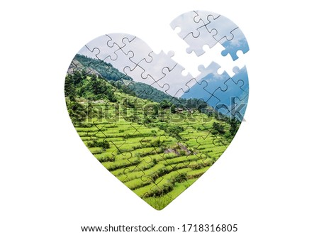 Heart shaped jigsaw puzzle with print of nature