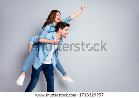 Profile photo pretty lady handsome guy couple carry piggyback meet adventures playful mood crazy people wear casual denim shirts outfit isolated grey color background
