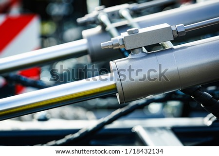Hydraulic system on modern heavy machine. Industrial detail piston in machinery. Technology. Royalty-Free Stock Photo #1718432134