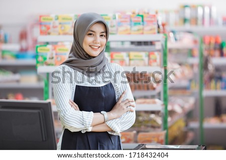 portrait of happy asian female shopkeeper Royalty-Free Stock Photo #1718432404