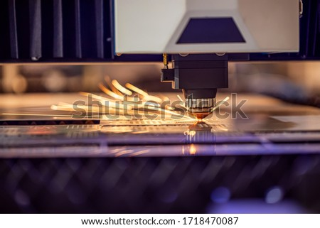 CNC Laser cutting of metal modern industrial technology. Laser cutting works by directing the output of a high-power laser through optics. Laser optics and CNC computer numerical control. #1718470087