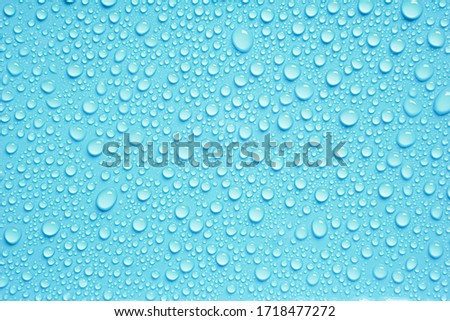 Beautiful big water droplets on the light blue background. Royalty-Free Stock Photo #1718477272