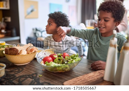 afro-american kids eating healthy food together. brother and sister. togetherness concept, sharing meal Royalty-Free Stock Photo #1718505667