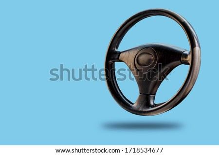 Car steering wheel, leather covered, button technology Royalty-Free Stock Photo #1718534677