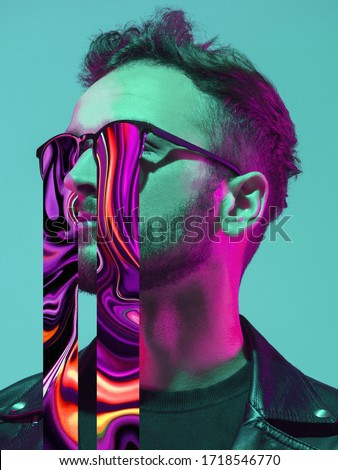 Modern man's portrait in sunglasses isolated on studio background in neon light. Concept of human emotions, facial expression, sales, ad. Stylish creative design, art vision, new look of artwork. #1718546770