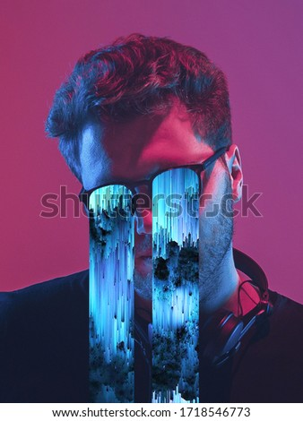 Modern man's portrait in sunglasses isolated on studio background in neon light. Concept of human emotions, facial expression, sales, ad. Stylish creative design, art vision, new look of artwork. Royalty-Free Stock Photo #1718546773