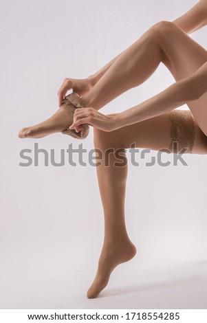 beautiful woman legs in tights #1718554285