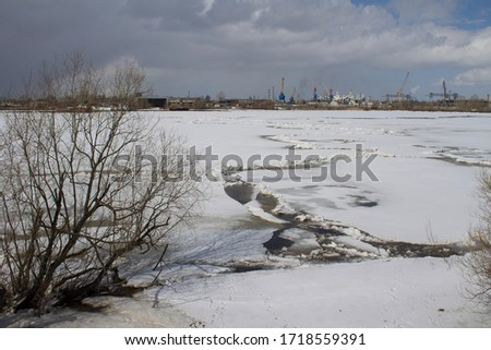 the view from the shore on the ice of the Northern Dvina river, Arkhangelsk, Russia #1718559391