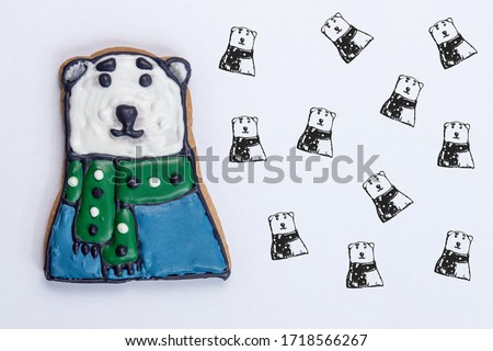gingerbread for christmas or new year polar bear with a green scarf and blue sweater