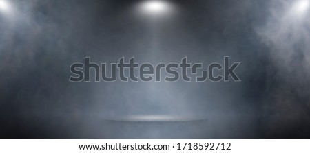 Background of an empty dark and gray White spotlight stage design studio, smoke, smog, empty dark scene, concrete floo, interior texture for display products, nightclub entertainment background. Royalty-Free Stock Photo #1718592712