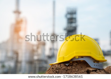 Helmet worker at refinery construction site Royalty-Free Stock Photo #1718638561