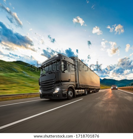 Truck with container on highway, cargo transportation concept. Shaving effect. #1718701876