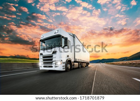 Truck with container on highway, cargo transportation concept. Shaving effect. Royalty-Free Stock Photo #1718701879