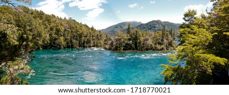 Panoramic photo of blue lake and mountains #1718770021