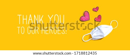 Thank You to Our Heroes message with a face mask and heart drawings Royalty-Free Stock Photo #1718812435