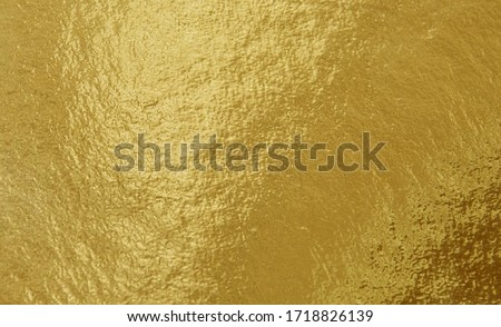 Gold foil texture background with uneven surface #1718826139