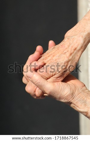Old women' hands on the sun #1718867545