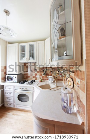 Minsk, Belarus - May, 2013: Classic design kitchen with white elements #1718930971