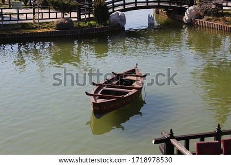a small boat in the middle of the lake #1718978530