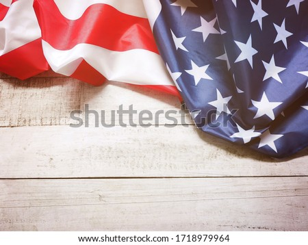 Closeup of American flag on vintage wood for 4th of July holiday background, filter effect. Happy flag day. #1718979964