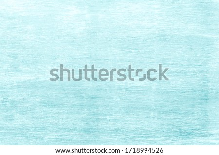 Abstract table top dark wood texture on light blue color background concept brush teal, mint green, turquoise colour wooden. Beach wall backdrop with tidy board detail streak finishing for summer.