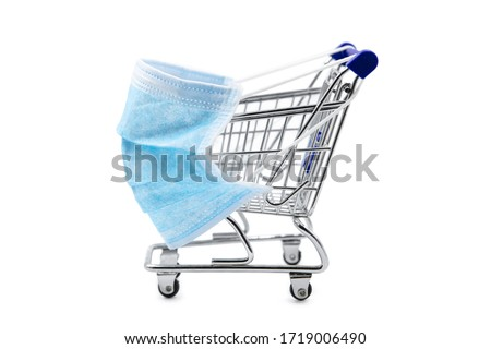 Surgical face mask on little shopping trolley or cart, mandatory masking on supermarkets, coronavirus and covid-19, Maskenpflicht #1719006490